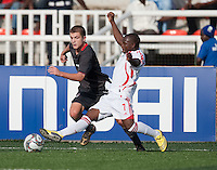 Tonny Chitsulo (7) slide tackles Tyler Polak. US Men's National Team Under 17 defeated Malawi 1-0 in the second game of the FIFA 2009 Under-17 World Cup at Sani Abacha Stadium in Kano, Nigeria on October 29, 2009.
