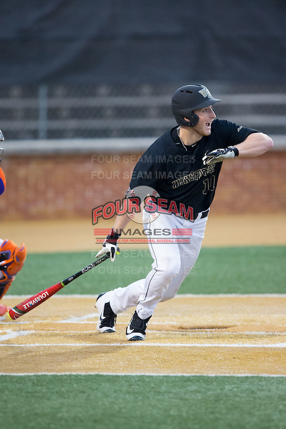 Jonathan Pryor (11) of the Wake Forest Demon Deacons follows through on his swing against the Clemson Tigers at David F. Couch Ballpark on March 12, 2016 in Winston-Salem, North Carolina.  The Tigers defeated the Demon Deacons 6-5.  (Brian Westerholt/Four Seam Images)