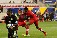 Harrison, NJ - Friday July 07, 2017: Alphonso Davies, Russell Teibert, Donovan Leon during a 2017 CONCACAF Gold Cup Group A match between the men's national teams of French Guiana (GUF) and Canada (CAN) at Red Bull Arena.
