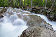 """Franconia Notch State Park - The Pemigewasset River just above """"The Basin"""" viewing area in Lincoln, New Hampshire during the spring snowmelt season."""