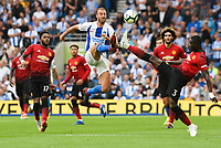 Glenn Murray of Brighton & Hove Albion (17) and Eric Bailly of Manchester United (3) challenge for the ball  during the Premier League match between Brighton and Hove Albion and Manchester United at the American Express Community Stadium, Brighton and Hove, England on 19 August 2018. Photo by Edward Thomas / PRiME Media Images.
