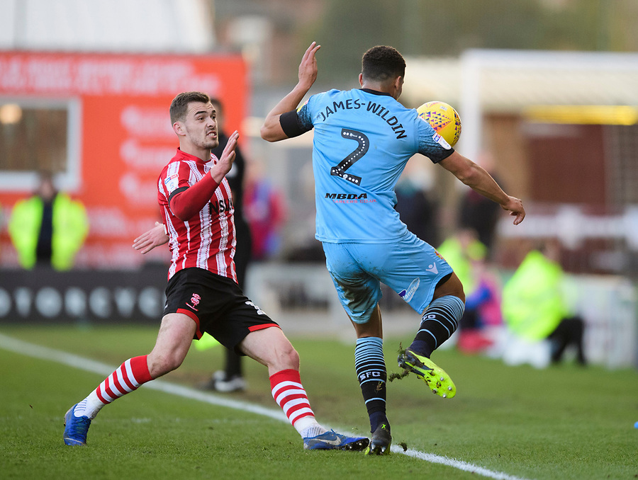 Stevenage's Luther Wildin under pressure from Lincoln City's Harry Toffolo<br /> <br /> Photographer Chris Vaughan/CameraSport<br /> <br /> The EFL Sky Bet League Two - Lincoln City v Stevenage - Saturday 16th February 2019 - Sincil Bank - Lincoln<br /> <br /> World Copyright © 2019 CameraSport. All rights reserved. 43 Linden Ave. Countesthorpe. Leicester. England. LE8 5PG - Tel: +44 (0) 116 277 4147 - admin@camerasport.com - www.camerasport.com
