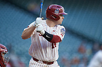 Justin Mitchell (14) of the Oklahoma Sooners at bat against the Arkansas Razorbacks in game two of the 2020 Shriners Hospitals for Children College Classic at Minute Maid Park on February 28, 2020 in Houston, Texas. The Sooners defeated the Razorbacks 6-3. (Brian Westerholt/Four Seam Images)