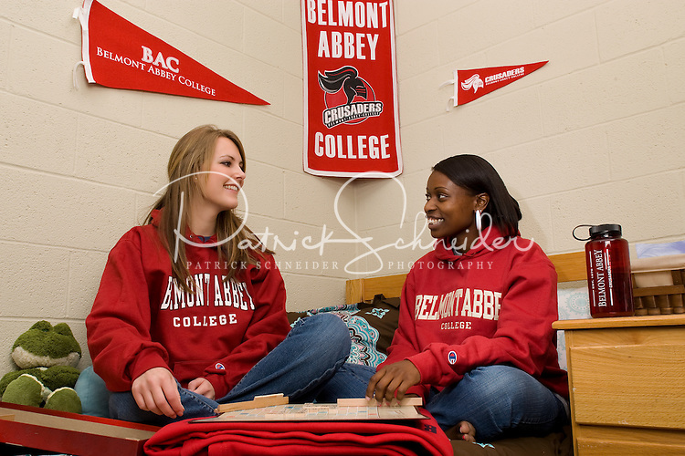 Two college students enjoy time in their dorm room in Belmont, NC.