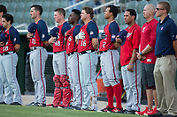 Members of the Hagerstown Suns stand for the National Anthem prior to the game against the Kannapolis Intimidators at Kannapolis Intimidators Stadium on July 10, 2017 in Kannapolis, North Carolina.  The Suns defeated the Intimidators 8-5.  (Brian Westerholt/Four Seam Images)