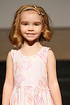 Model walks runway in an outfit by Pickles N Roses, during the petitePARADE Children's Club fashion show at the Jacob Javits Center in New York City, on January 9, 2016.