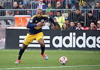 Toronto, Ontario - May 17, 2014: New York Red Bulls forward Thierry Henry #14 runs up field with the ball during a game between the New York Red Bulls and Toronto FC at BMO Field. Toronto FC won 2-0.