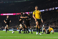 Israel Folau of Australia looks distraught as Ma'a Nonu of New Zealand scores a try during the Rugby World Cup Final between New Zealand and Australia - 31/10/2015 - Twickenham Stadium, London<br /> Mandatory Credit: Rob Munro/Stewart Communications