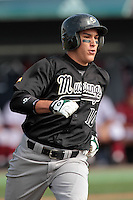 Nick Torres #10 of the Cal Poly Mustangs runs to first base against the Loyola Marymount Lions at Page Stadium on February 25, 2012 in Los Angeles,California. Cal Poly defeated LMU 12-5.(Larry Goren/Four Seam Images)