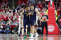 RALEIGH, NC - JANUARY 9: John Mooney #33 of the University of Notre Dame is consoled by Prentiss Hubb #3 after fouling out during a game between Notre Dame and NC State at PNC Arena on January 9, 2020 in Raleigh, North Carolina.