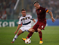 Calcio, Champions League, Gruppo E: Roma vs Bayern Monaco. Roma, stadio Olimpico, 21 ottobre 2014.<br /> Roma's Radja Nainggolan is challenged by Bayern's Philipp Lahm, left, during the Group E Champions League football match between AS Roma and Bayern at Rome's Olympic stadium, 21 October 2014.<br /> UPDATE IMAGES PRESS/Isabella Bonotto