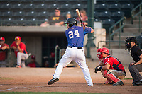 Missoula Osprey third baseman Buddy Kennedy (24) at bat in front of catcher Griffin Barnes (28) and home plate umpire Matt Herrera during a Pioneer League game against the Orem Owlz at Ogren Park Allegiance Field on August 19, 2018 in Missoula, Montana. The Missoula Osprey defeated the Orem Owlz by a score of 8-0. (Zachary Lucy/Four Seam Images)