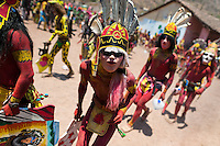 "Cora Indians, wearing colorful masks, run during the religious ritual celebration of Semana Santa (Holy Week) in Jesús María, Nayarit, Mexico, 22 April 2011. The annual week-long Easter festivity (called ""La Judea""), performed in the rugged mountain country of Sierra del Nayar, merges indigenous tradition (agricultural cycle and the regeneration of life worshipping) and animistic beliefs with the Christian dogma. Each year in the spring, the Cora villages are taken over by hundreds of wildly running men. Painted all over their semi-naked bodies, fighting ritual battles with wooden swords and dancing crazily, they perform demons (the evil) that metaphorically chase Jesus Christ, kill him, but finally fail due to his resurrection. La Judea, the Holy Week sacred spectacle, represents the most truthful expression of the Coras' culture, religiosity and identity."