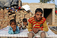 Chand Singh, 10, sits outside his home in the village of Teejaruhela. He has suffered from spastic cerebral palsy since birth. It is believed that excessive pesticide use in the region over the past 30-40 years has led to the accumulation of dangerous levels of toxins such as uranium, lead and mercury which are contributing to increased health problems in rural communities. It's a hidden epidemic which is gripping the Punjab region in northeast India which for decades has been the country's 'bread basket'. Local farmers and their families are now paying the price for the country's 'Green Revolution'.