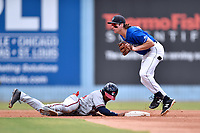 Asheville Tourists shortstop Ryan Vilade (4) after attempting to put a tag on Justin Dean (14) as he slides back to second base during a game against the Rome Braves at McCormick Field on September 3, 2018 in Asheville, North Carolina. The Tourists defeated the Braves 5-4. (Tony Farlow/Four Seam Images)