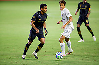 CARSON, CA - SEPTEMBER 06: Team mates Eddie Segura #4 of LAFC chases down a loose ball with Ethan Zubak #29 of Los Angeles Galaxy during a game between Los Angeles FC and Los Angeles Galaxy at Dignity Health Sports Park on September 06, 2020 in Carson, California.