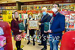 """Listowel Food Fair Book of the Year : Jimmy Deenihan, chairman Listowel Food Fair presenting Maura O'Connell Foley, author of """"The Wild Atlantic Kitchen"""" with her food book of the year award at Woulfe's Book Shop, Listowel  on Thursday last. L-R: Carmel Myers, Woulfe's Book Shop, Maura O'Connell Foley, Wild Atlantic Kitchen, Jimmy Deenihan, Chair Listowel Food Fair & Jeremy Murphy, Listowel Writers week."""