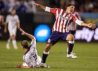 LA Galaxy's Gregg Berhalter prevents Chivas USA's Alecko Eskandarian from reaching the ball. Chivas USA and the LA Galaxy played to a 0-0 draw at Home Depot Center stadium in Carson, California on Saturday April 11, 2009.  .