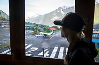 Watching an airplane come in at the Lukla airport, Nepal