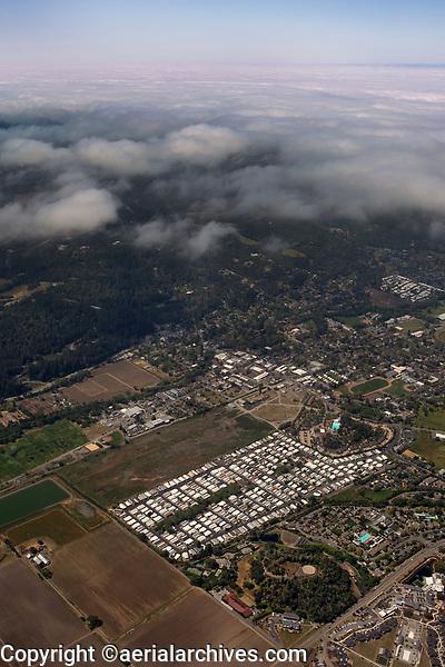 aerial photograph of Calistoga with receding fog, Napa County, California