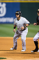Ramon Cabrera (38) of the Louisville Bats takes his lead off of first base against the Charlotte Knights at BB&T BallPark on May 12, 2015 in Charlotte, North Carolina.  The Knights defeated the Bats 4-0.  (Brian Westerholt/Four Seam Images)
