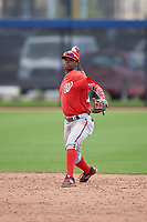 Washington Nationals shortstop Edwin Lora (10) throws to first base during a minor league Spring Training game against the Houston Astros on March 28, 2017 at the FITTEAM Ballpark of the Palm Beaches in West Palm Beach, Florida.  (Mike Janes/Four Seam Images)
