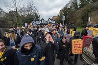 Protest and occupation at Sussex University 25-3-13 Students at Sussex University hold a march in support of occupations on the campus against cuts and privatsation of staff jobs. Demonstrators scuffled with riot Police and forced their way into the buidling of the Vice Chancellor.
