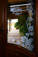 Glass door with the inscription La Puebla H Stagnari Family Wines. Bodega Vinos Finos H Stagnari Winery, La Puebla, La Paz, Canelones, Montevideo, Uruguay, South America