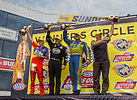 Jun. 2, 2013; Englishtown, NJ, USA: NHRA (L-R) pro stock motorcycle rider Michael Ray , top fuel dragster driver Shawn Langdon , funny car driver Matt Hagan and pro stock driver Mike Edwards celebrate after winning the Summer Nationals at Raceway Park. Mandatory Credit: Mark J. Rebilas-