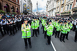 © Joel Goodman - 07973 332324 . 30/06/2011 . London , UK . Hundreds of police block Whitehall . Tens of thousands of public sector workers demonstrate and march through the City of London in protest at proposed changes to their pensions . Photo credit : Joel Goodman