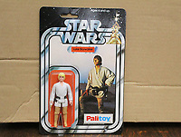 BNPS.co.uk (01202 558833)<br /> Pic: Mitchells/BNPS<br /> <br /> Pictured: The Luke Skywalker in its original packaging.<br /> <br /> A Star Wars action figure which had been languishing at the bottom of a toy box for 44 years has sold for a staggering £3,500 - 43 times its estimate.<br /> <br /> The Palitoy Luke Skywalker 3.75ins toy was still in its original packaging and had never been opened.<br /> <br /> The vendor was given it as a 10 year old by his parents in 1977 who wisely told him to never play with it in case its value increased over the years.
