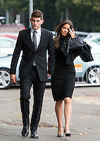CARDIFF, 4th October 2016. Former footballer Ched Evans arrives with girlfriend Natasha Massey at Cardiff Crown Court to face a re-trial for charges of rape.