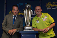 13.06.2014. London, England.  Rileys Sports Bar, Haymarket. The  launch of William Hill's sponsorship as title sponsor of the 2015 World Darts Championship. Reigning World Darts Champion Michael van Gerwen [L], William Hill Chief Marketing Officer Kristof Fahy [R].