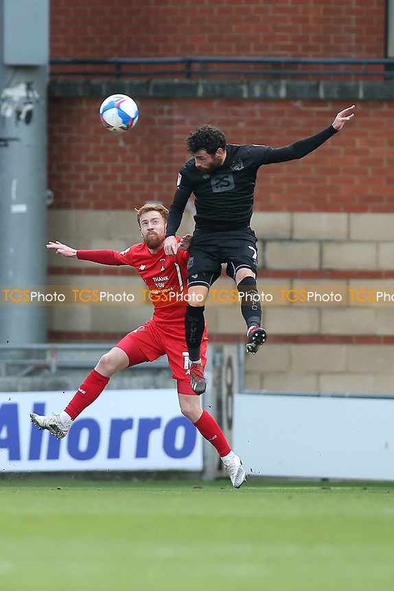David Worrall of Port Vale and James Brophy of Leyton Orient during Leyton Orient vs Port Vale, Sky Bet EFL League 2 Football at The Breyer Group Stadium on 20th February 2021