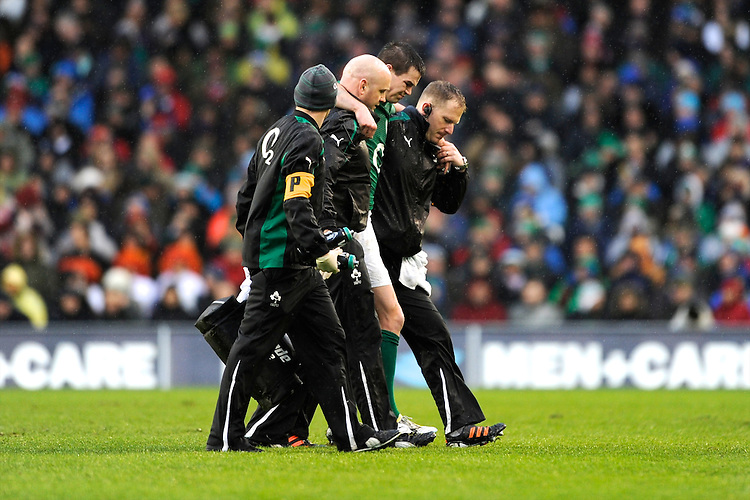 Jonathan Sexton of Ireland leaves the pitch injured during the RBS 6 Nations match between Ireland and England at the Aviva Stadium, Dublin on Sunday 10 February 2013 (Photo by Rob Munro)