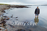 Bob Fitzsimons from the Tralee Bay Swimming Club showing how shallow the water is, where the proposed diving boards will be reinstated in Fenit