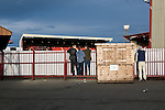 Barnsley 1 Millwall 0, 22/02/2014. Oakwell, Championship. Millwall make the journey from south London to South Yorkshire for a Championship relegation battle with Barnsley. A group of lads share a beer whilst watching the action over a fence.  Photo by Simon Gill.