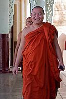 Myanmar, Burma.   Buddhist Monk, Shwezigon (Shwezegon)  Pagoda, Nyaung Oo, near Bagan.
