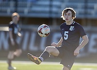 NWA Democrat-Gazette/CHARLIE KAIJO Bentonville West High School defender Ethan Stockdale (5) kicks during a soccer game, Friday, March 15, 2019 at Bentonville West in Centerton.