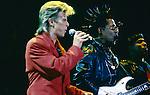 David Bowie, Carlos Alomar & Carmine Rojas performing live at Anaheim Stadium , CA - Aug 8, 1987