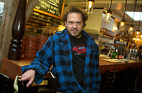 Martin Picard, Owner of AU PIED DE COCHON restaurant in<br /> Montreal, canada.<br /> <br /> The restaurant's chef and owner, Martin Picard, is well known for his way with starters such as onion soup, deep-fried oreilles de Crisse pork rinds, four kinds of crabs (summer only) and foie gras. In fact, there are four foie gras dishes on the menu, from foie gras flan to foie gras poutine - yes, to the fries, the gravy and the cheese, the chef has adde dof oie gras! When your waiter sweetly tempts you with the now specialty item made with clever varietals, obey: This is a seriously excellent adult concoction. Crispy skin-on fries, tangled with cheese and gravy, were topped with two chunks of foie gras, a reinvention of MontrealŐs signature.<br /> <br /> photo : (c)  Images Distribution