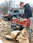 WATERTOWN CT. - 27 December 2019-1227SV02-Jim Paige of Evergreen Lawn and Landscaping splits and piles wood for sale on Main Street in Watertown Friday. With the colder weather on it way they sell between 15 and 20 cords of wood a week.<br /> Steven Valenti Republican-American