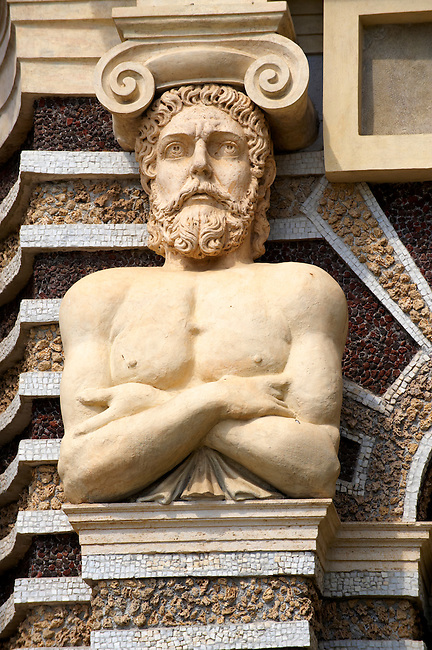 17th century atlas supporting the coloumns. The Organ fountain, 1566, housing organ pipies driven by air from the fountains. Villa d'Este, Tivoli, Italy - Unesco World Heritage Site.
