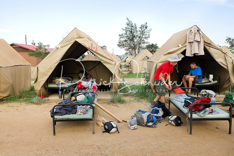 Photo story of Philmont Scout Ranch in Cimarron, New Mexico, taken during a Boy Scout Troop backpack trip in the summer of 2013. Photo is part of a comprehensive picture package which shows in-depth photography of a BSA Ventures crew on a trek. In this photo,  Boy Scout Venture crew members repacks his clothes  for the trip home after arriving back in base camp after completing his trek through the backcountry.<br /> Photo by travel photograph: PatrickschneiderPhoto.com
