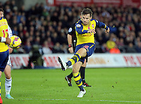 Sunday 09 November 2014 <br /> Aaron Ramsey of Arsenal shoots wide<br /> Barclays Premier League, Swansea City FC v Arsenal City at the Liberty Stadium, Swansea, Great Britain.