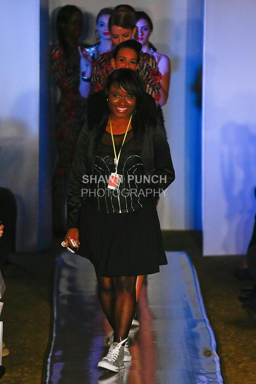 Fashion designer Dareyna Swann walks runway at the close of her Swarey Designs Fall 2012 collection fashion show, at Plitzs Fashion Week New York, during New York Fashion Week Fall 2012.