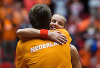 The Netherlands, Den Bosch, 20.04.2014. Fed Cup Netherlands-Japan, Arantxa Rus (NED) wins the deciding point, and falls into the arms of captain Paul Haarhuis, Holland goes to the world group<br /> Photo:Tennisimages/Henk Koster