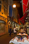 Women walking along an outdoor restaurant near the Great Square, Brussels, Belgium,