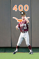 Texas A&M Aggies outfielder Krey Bratsen #13 makes a catch against the Texas Longhorns in NCAA Big XII Conference baseball on May 21, 2011 at Disch Falk Field in Austin, Texas. (Photo by Andrew Woolley / Four Seam Images)