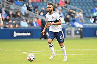 KANSAS CITY, KS - MAY 16: Caio Alexandre #8 Vancouver Whitecaps with the ball during a game between Vancouver Whitecaps and Sporting Kansas City at Children's Mercy Park on May 16, 2021 in Kansas City, Kansas.